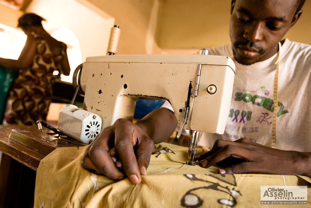 Men use sewing machines to make clothes at the Village Artisanal de Ouagadougou, a cooperative that employs dozens of artisans who work in different mediums, in Ouagadougou, Burkina Faso, on Monday November 3, 2008..