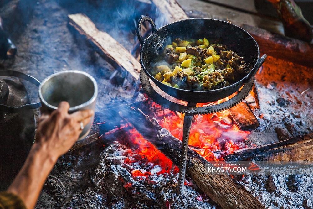 Pork Potato being cooked on firewood in a forest bamboo hut in talle wildlife sanctuary, pange.