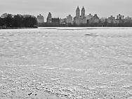 Ice and snow drift on a Reservoir in deep freeze; Central Park, New York City.
