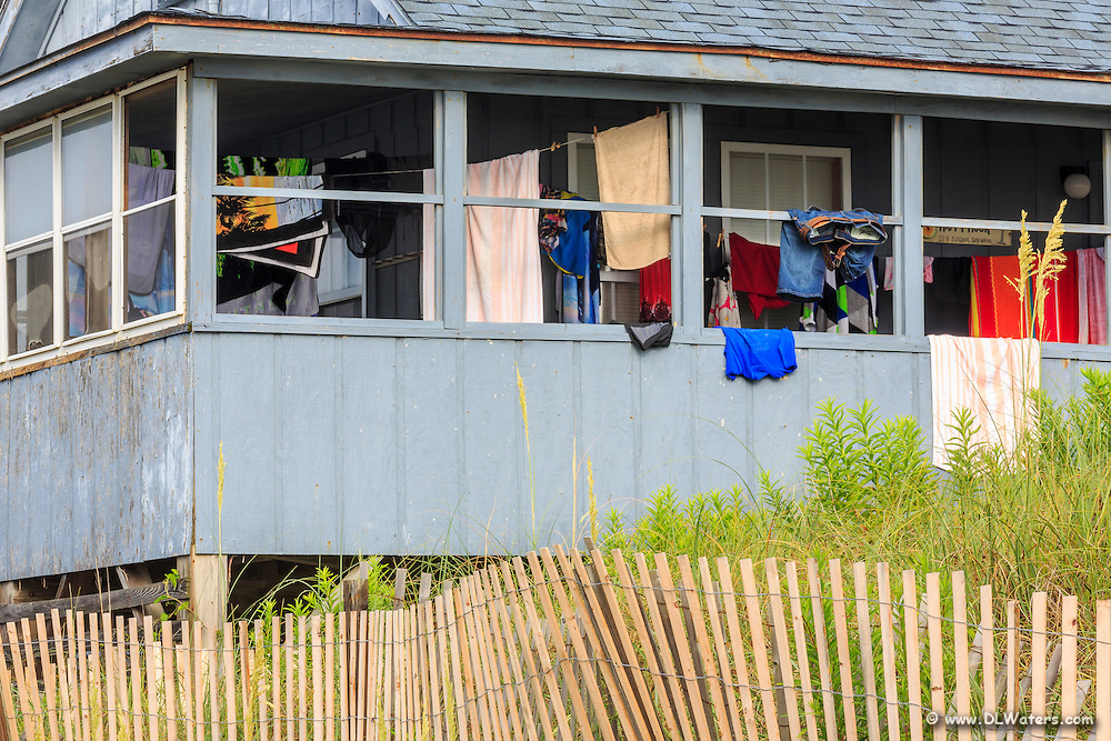 Beach towels and bathing suits drying on the back porch of a beach house in Kill Devil Hills, NC.