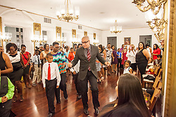 """Global Program Director, Rodney Lopez, leads students and their loved ones in dancing """"The Stomp"""" a fun way for everyone to dance together.  Dancing Classrooms Virgin Islands culminating event at the Government House Ballroom in Christiansted.  St. Croix, USVI.  18 December 2015.  © Aisha-Zakiya Boyd"""