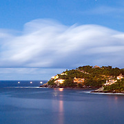 Night shot of the headland at Zihuatanejo, Mexico