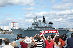 © Under License to London News Pictures. 12/08/2013. HMS Illustrious leaving Portsmouth to take part in exercise Cougar, which will include a stop at Gibraltar, amid tensions between Spain and the UK. Picture credit: Bryan Moffat/LNP