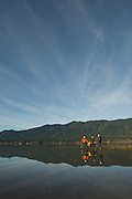 Cyclists on the shore of Lake Quinault - Olympic National Park - Washington State