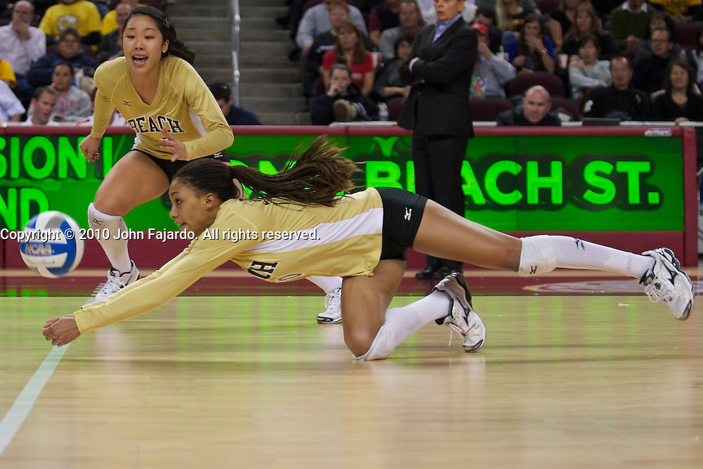 Janisa Johnson digs the attack in the first round match against the University of San Diego in the 2010 NCAA Women's Volleyball Tournament at the Galen Center, Los Angeles, Calif., Friday, Dec. 3, 2010