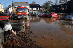 ©London News pictures... 17/11/2010. A fire engine drives through the mud left after the water receded. The River Fowey burst its banks at Lost Withiel in Cornwall. today (Wednesday). Some people have been left trapped in their cars and homes in parts of Cornwall as heavy rain and gale-force winds caused flooding and disruption.