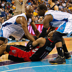 January 17, 2011; New Orleans, LA, USA; New Orleans Hornets point guard Chris Paul (3) and point guard Jarrett Jack (2) fight over a loose ball with Toronto Raptors shooting guard DeMar DeRozan (10) during the fourth quarter at the New Orleans Arena. The Hornets defeated the Raptors 85-81.  Mandatory Credit: Derick E. Hingle