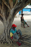 Ghana, Adaklu, Titikope, 2007. Villagers relax under one of the many trees that provide shelter from the midday sun.
