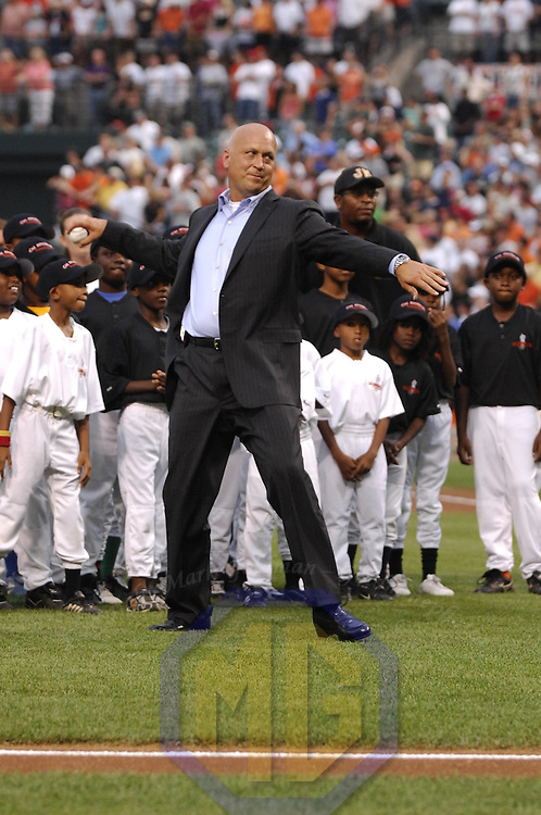 12 July 2007:  Former Baltimore Orioles Hall of Fame shortstop Cal Ripken Jr. throws out the ceremonial first pitch at the Hall of Fame Send-Off ceremony honoring former Oriole Ripken prior to the game between the Tampa Bay Devil Rays and the Baltimore Orioles.  Ripken will be inducted to the Baseball Hall of Fame Sunday, July 29.  The Orioles defeated the Devil Rays 3-0 at Camden Yards in Baltimore, MD.   ****For Editorial Use Only****.