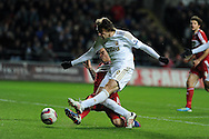 Swansea city's Michu is tackled by Boro's Seb Hines. Capital one cup, quarter final, Swansea city v Middlesbrough at the Liberty Stadium in Swansea, South Wales on Wednesday 12th Dec 2012. pic by Andrew Orchard, Andrew Orchard sports photography,