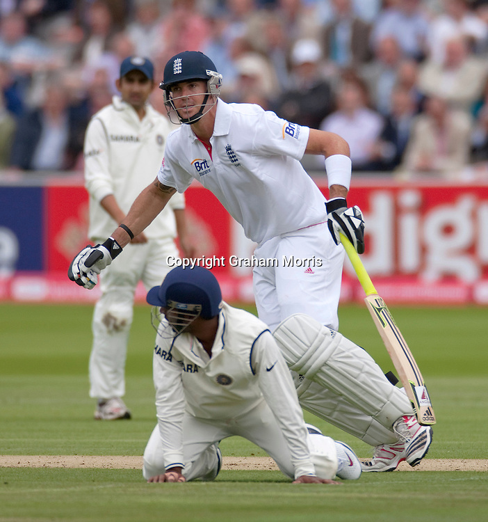 Kevin Pietersen past close fielder Abhinav Mukund during the first npower Test Match between England and India at Lord's Cricket Ground, London.  Photo: Graham Morris (Tel: +44(0)20 8969 4192 Email: sales@cricketpix.com) 21/07/11