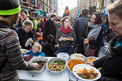 London, UK. 9th February, 2019. Food provided by activists from Extinction Rebellion blocking Kingsland Road in Dalston as part of a 'Saturday street party' intended as a means of engagement around climate change and environmental issues with the local community.