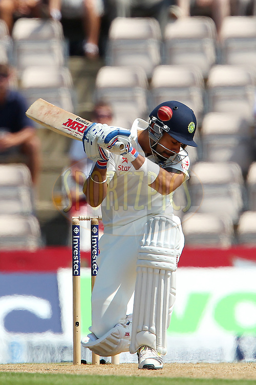 Virat Kohli of India avoids a rising delivery from Chris Woakes of England during day three of the third Investec Test Match between England and India held at The Ageas Bowl cricket ground in Southampton, England on the 29th July 2014<br /> <br /> Photo by Ron Gaunt / SPORTZPICS/ BCCI