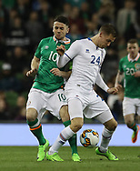 Robbie Brady of Republic of Ireland and Kjartan Henry Finnbogason of Iceland during the International Friendly match at the Aviva Stadium, Dublin<br /> Picture by Lorraine O'Sullivan/Focus Images Ltd +353 872341584<br /> 28/03/2017