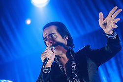 A shadow forms on the face of Nick Cave, of Nick Cave and the Bad Seeds, on stage tonight at The Barrowlands, Glasgow, Scotland.<br /> &copy;Michael Schofield.