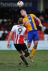 Jamie McGuire of Mansfield Town and Danny Wright of Cheltenham Town compete the highball  - Mandatory by-line: Nizaam Jones/JMP- 04/03/2017 - FOOTBALL - LCI Rail Stadium - Cheltenham, England - Cheltenham Town v Mansfield Town -Sky Bet League Two