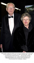 MR & MRS HANS RAUSING the food packaging multi-millionaire, at an exhibition in London on 29th January 2001.	OKU 26