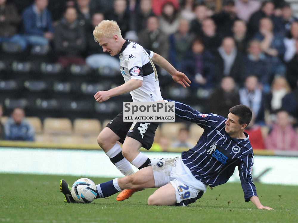 Millwalls Owin Garvan slides in on Derbys Will Hughes, Derby County v Millwall Sky Bet Championship, Pride Park, Saturday 8th March 2014