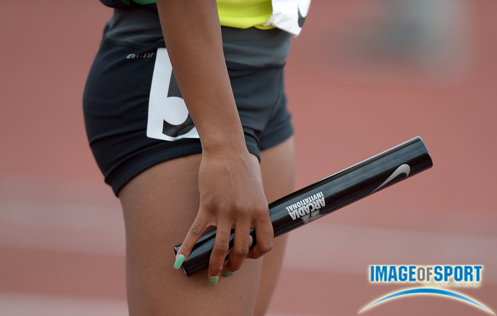 Apr 12, 2014; Arcadia, CA, USA; Kenyla Miles of Long Beach Poly holds a baton before the start of the girls 4 x 100m relay in the 47th Arcadia Invitational at Arcadia High.