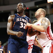 Nnanna Egwu #32 of the Illinois Fighting Illini fights for position with Dom Morris #15 of the Boston University Terriers for a rebound during the NIT First Round game at Agganis Arena on March 19, 2014 in Boston, Massachusetts . (Photo by Elan Kawesch)