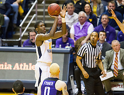 Jan 7, 2017; Morgantown, WV, USA; West Virginia Mountaineers forward Lamont West (15) shoots a three pointer during the first half against the TCU Horned Frogs at WVU Coliseum. Mandatory Credit: Ben Queen-USA TODAY Sports
