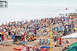 © Licensed to London News Pictures. 04/08/2016. Brighton, UK. Thousands of people take to the beach in Brighton and Hove as hot and sunny weather returns to the seaside resort. Photo credit: Hugo Michiels/LNP