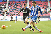 Wigan Athletic Forward, Yanic Wildschut unleashes a cross into the box during the Sky Bet League 1 match between Wigan Athletic and Bury at the DW Stadium, Wigan, England on 27 February 2016. Photo by Mark Pollitt.