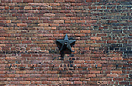 Brick wall with star-shape washer