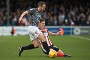 Lincoln City Midfielder Alex Woodyard is tackled by Coventry City Midfielder Liam Kelly during the EFL Sky Bet League 2 match between Lincoln City and Coventry City at Sincil Bank, Lincoln, United Kingdom on 18 November 2017. Photo by Craig Zadoroznyj.
