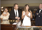 Antonella Miro, David Furnish and Elizabeth hurley. Grosvenor House Antiques Fair charity Gala preview. 13 June 2002. © Copyright Photograph by Dafydd Jones 66 Stockwell Park Rd. London SW9 0DA Tel 020 7733 0108 www.dafjones.com
