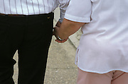 man and woman walking and holding hands