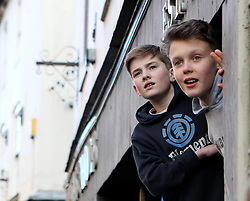 Youngster watch The Shrovetide Football from a elevated position - Mandatory byline: Robbie Stephenson/JMP - 09/02/2016 - FOOTBALL -  - Ashbourne, England - Up'Ards v Down'Ards - Royal Shrovetide Football