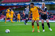 Tristan Abrahams of Newport County holds off Ludvig Ohman of Grimsby Town during the The FA Cup match between Grimsby Town FC and Newport County at Blundell Park, Grimsby, United Kingdom on 9 November 2019.