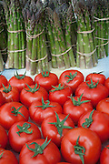 Tomatoes and asparagus for sale, Union Square Greenmarket, New York City.