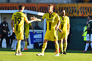 Kyle McFadzean (5) of Burton Albion celebrates the 3-2 win over Plymouth at full time with Reece Hutchinson (19) of Burton Albion during the EFL Sky Bet League 1 match between Plymouth Argyle and Burton Albion at Home Park, Plymouth, England on 20 October 2018.