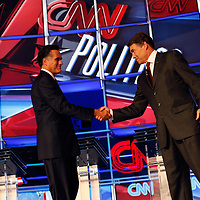 TAMPA, FL -- September 12, 2011 -- Republican Presidential candidates Gov. Mitt Romney and Gov. Rick Perry shake hands during the CNN/Tea Party Republican Debate at the Florida State Fairgrounds on Monday, September 12, 2011.  Eight Republican Presidential candidates squared off with host Wolf Blitzer in the battleground state of Florida for the 2012 Election.    (Chip Litherland for The New York Times)
