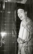 Man pees in shower, Happy Mondays Factory Records party, Manchester, 1989
