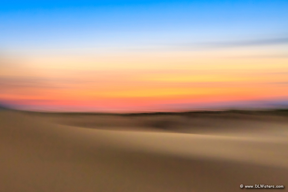 An impression of Jockey's Ridge State Park at sunset. Moving the camera while the shutter is open creates impressionistic photographs.