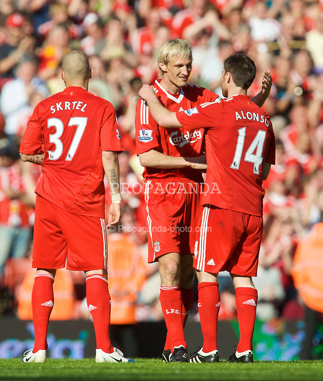 LIVERPOOL, ENGLAND - Sunday, May 24, 2009: Liverpool's Sami Hyypia embraces team-mate Xabi Alonso after making his final appearance for the club after a decade of service, during the Premiership match against Tottenham Hotspur at Anfield. (Photo by: David Rawcliffe/Propaganda)