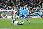 Danny Mayor tackles Ryan Broom  during the EFL Sky Bet League 2 match between Plymouth Argyle and Cheltenham Town at Home Park, Plymouth, England on 21 September 2019.