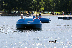 © Licensed to London News Pictures. 22/08/2019. London, UK. People in a pedal boat in Serpentine's boating lake in Hyde Park on a warm and sunny day in London. According to the Met Office, the temperatures are forecast to increase to 30 degrees celsius over the bank holiday weekend. Photo credit: Dinendra Haria/LNP