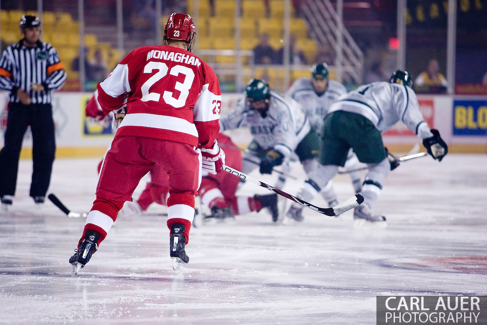 October 13, 2007 - Anchorage, Alaska:  Ryan Monaghan (23) of the Boston University Terriers looks for the puck as players go down in front of him during the hard fought game 4 of the Nye Frontier Classic at the Sullivan Arena.  UAA and BU would tie 4-4 giving Robert Morris University the title of Nye Frontier Classic Champion.