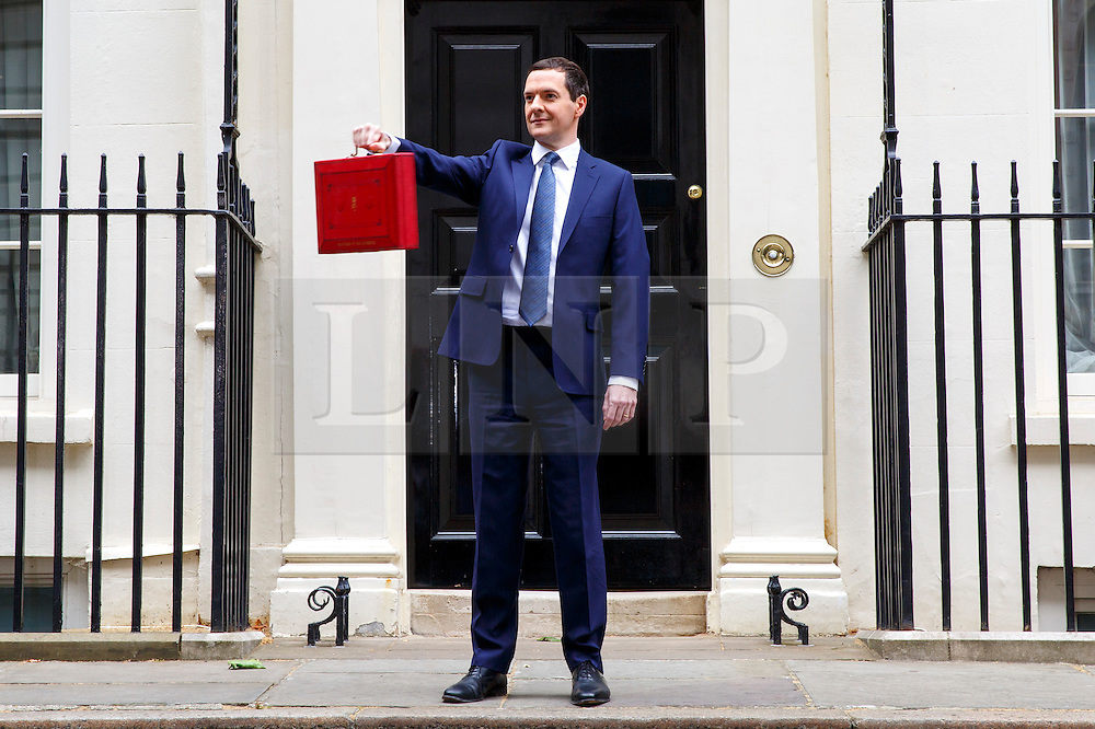 © Licensed to London News Pictures. 08/07/2015. Westminster, UK. Chancellor of the Exchequer George Osborne posing for photographers outside 11 Downing Street before presenting his summer budget to Parliament on July 8, 2015. Photo credit: Tolga Akmen/LNP