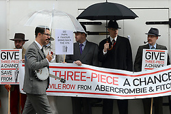 © Licensed to London News Pictures. 23/04/2012. London, UK . A protest organised today, 23rd April 2012, by Chap Magazine and the Tailors of Savile Row to petition against the proposed opening of a new Abercrombie and Fitch Store on Savile Row. The protesters gathered to sing 'Give 3 Piece A Chance' outside the present store on Burlington Gardens. Photo credit : Stephen Simpson/LNP