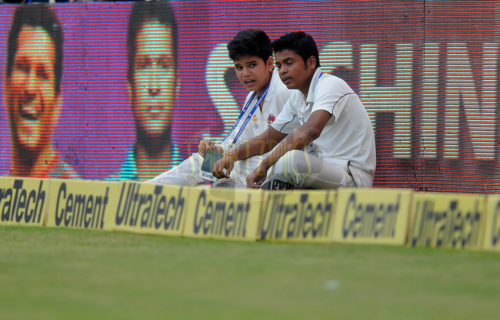 Arjun Tendulkar (L) son of Sachin Tendulkar of India stands as a ball boy  during day two of the second Star Sports test match between India and The West Indies held at The Wankhede Stadium in Mumbai, India on the 15th November 2013<br /> <br /> This test match is the 200th test match for Sachin Tendulkar and his last for India.  After a career spanning more than 24yrs Sachin is retiring from cricket and this test match is his last appearance on the field of play.<br /> <br /> <br /> Photo by: Pal PIllai - BCCI - SPORTZPICS<br /> <br /> Use of this image is subject to the terms and conditions as outlined by the BCCI. These terms can be found by following this link:<br /> <br /> http://sportzpics.photoshelter.com/gallery/BCCI-Image-Terms/G0000ahUVIIEBQ84/C0000whs75.ajndY