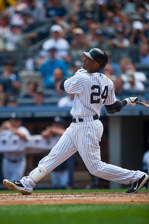 NEW YORK - JULY 14: Robinson Cano #24 of the New York Yankees bats during the game against the Los Angeles Angels at Yankee Stadium on July 14, 2012 in the Bronx borough of Manhattan. (Photo by Rob Tringali) *** Local Caption *** Robinson Cano