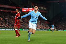 Manchester City's Leroy Sane celebrates scoring his side's first goal of the game during the Premier League match at Anfield, Liverpool.