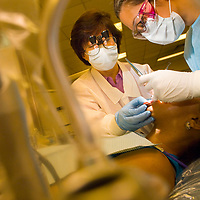 Clayton State dental student interns in clinical setting.