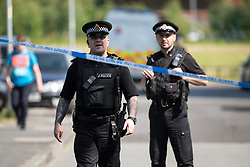 © Licensed to London News Pictures . 26/05/2017 . Manchester , UK . Police cordon at Somerton Court on Broadmoss Drive . A police cordon around the tower block in Blackley , North Manchester , in which a 12th floor flat was rented by Manchester Arena bomber Salman Abedi , ahead of his murderous attack at an Ariana Grande concert on Monday 22nd May 2017 . Photo credit : Joel Goodman/LNP