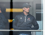 Somerset captain Tom Abell looks glum as he peers through the glass of the dressing room balcony window as the delay to the start of play continues during the Specsavers County Champ Div 1 match between Somerset County Cricket Club and Essex County Cricket Club at the Cooper Associates County Ground, Taunton, United Kingdom on 25 September 2019.